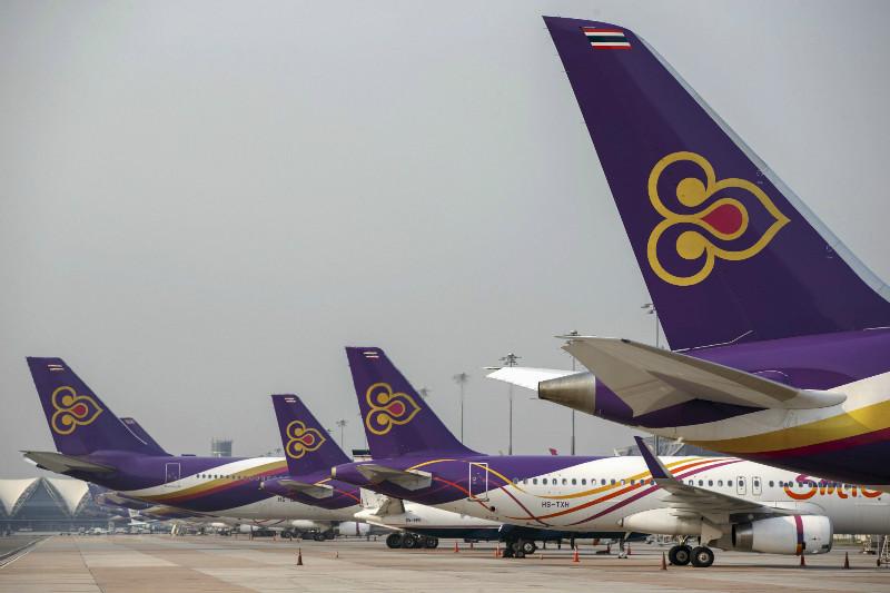 Thai Airways aircraft are parked on the tarmac at Bangkok's Suvarnabhumi International Airport March 27, 2015. — Reuters pic