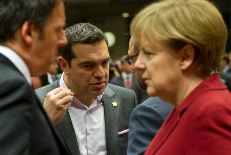 Tsipras (centre) has accused unnamed European countries of trying to force Greece out of the eurozone by failing to agree to the loans. — AFP pic