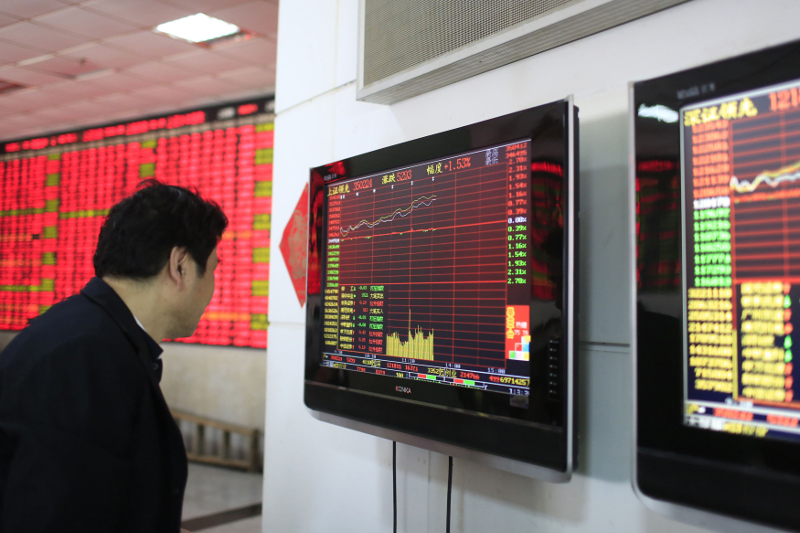 An investor looks at a computer screen showing stock information at a brokerage house in Shanghai March 17, 2015. — Reuters pic