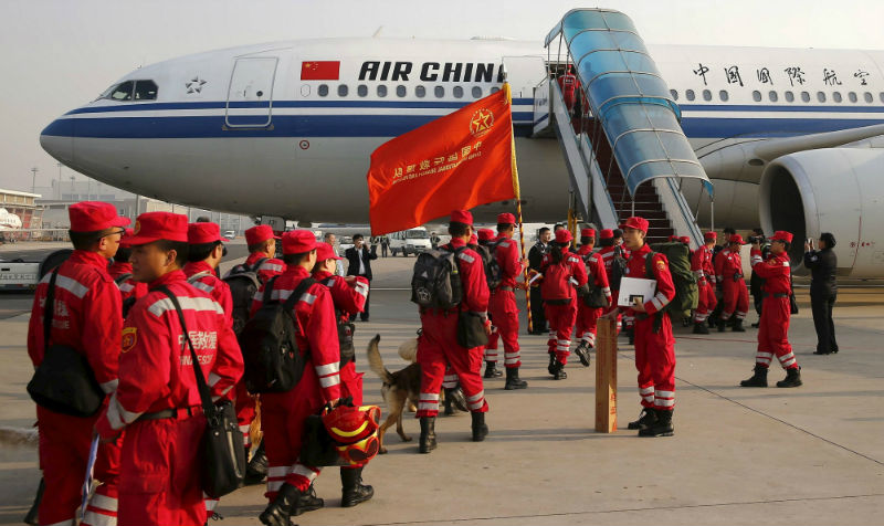 Taiwan has reported that Nepal rejected its offer of a 20-man rescue team. File picture shows members of Chinese International Search and Rescue Team and their rescue dogs boarding a charted plane to Kathmandu, at Beijing Airport. — Reuters pic
