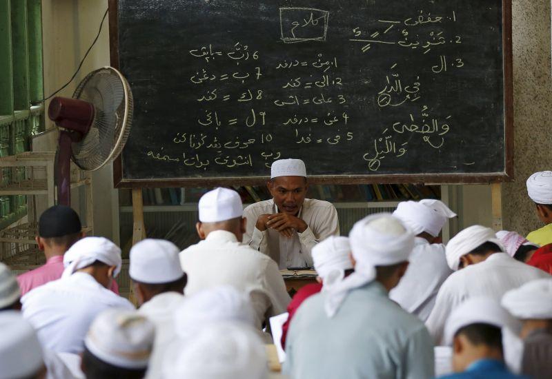 Islamic students take a class at Madrasah Ad-Diniyyah Al-Bakhriyyah in Kota Baaru, in the northern coastal state of Kelantan. ― Reuters pic