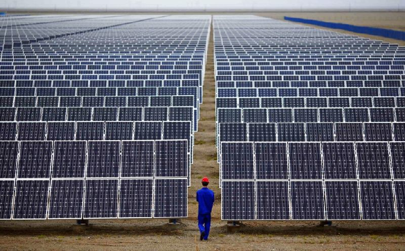 Rooftop panels will supplement solar farms like this one in Gansu province. — Reuters pic