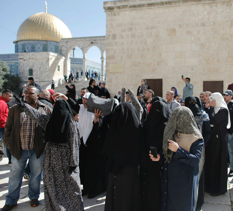 File picture shows Palestinian women protesting outside the Dome of the Rock mosque after Jewish worshippers entered the al-Aqsa mosque compound in Jerusalem under Israeli security forces protection on April 5, 2015. — AFP pic