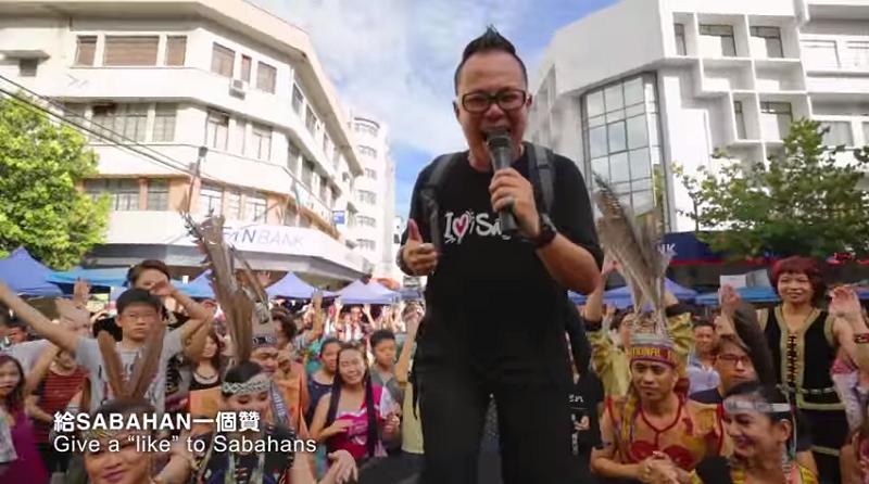 A screen capture of the music video 'I love Sino Kadazan' showing Johor-born Yu Tian Long.