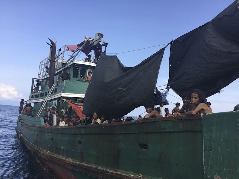 A wooden fishing boat carrying several hundred Rohingya migrants from Myanmar adrift west of the Thai mainland, May 14, 2015. — Picture by Thomas Fuller for The New York Times