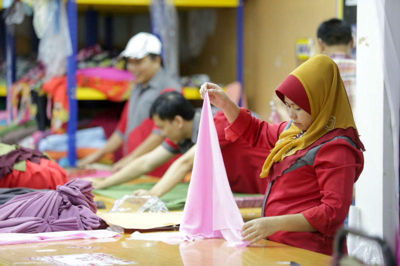 Workers making headscarves in Fareeda's Bangi store on April 30, 2015.