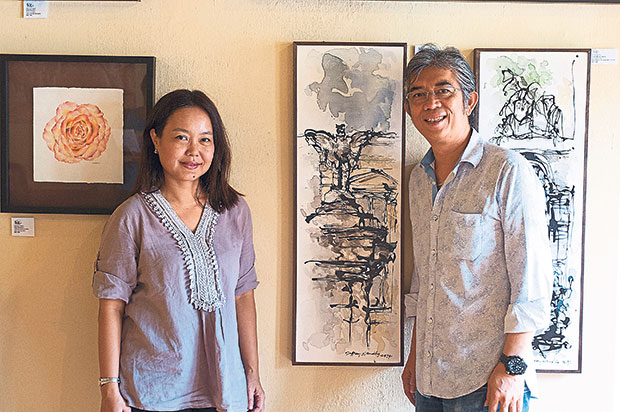 Masturah (left) and Jeffrey with their works of art. — Picture by K.E.Ooi