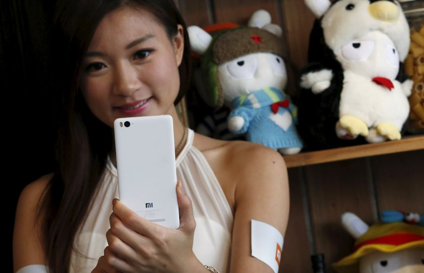 A model poses for a selfie with the newly launched Xiaomi Mi 4i phone in Hong Kong, May 6, 2015. — Reuters pic