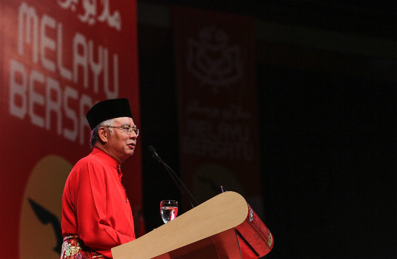Prime Minister Datuk Seri Najib Razak said that he was elected democratically and should be given a chance to finish his term as Umno party president. — Picture by Yusof Mat Isa