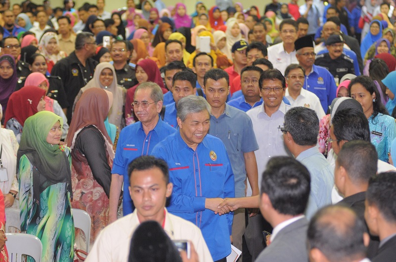 """The Malaysian government can make further spending cuts if it reduces the size of its """"bloated"""" civil service, an economist said. File picture shows Deputy Prime Minister Datuk Seri Dr Ahmad Zahid Hamidi meeting civil servants during a Workers' Day gathering in Penang. May 5, 2015. — Picture by KE Ooi"""