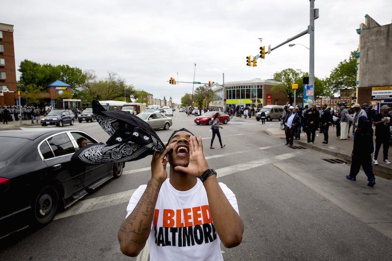 People react as police line up at North Avenue and Pennsylvania Avenue in Baltimore, Maryland, May 1, 2015. — Reuters pic