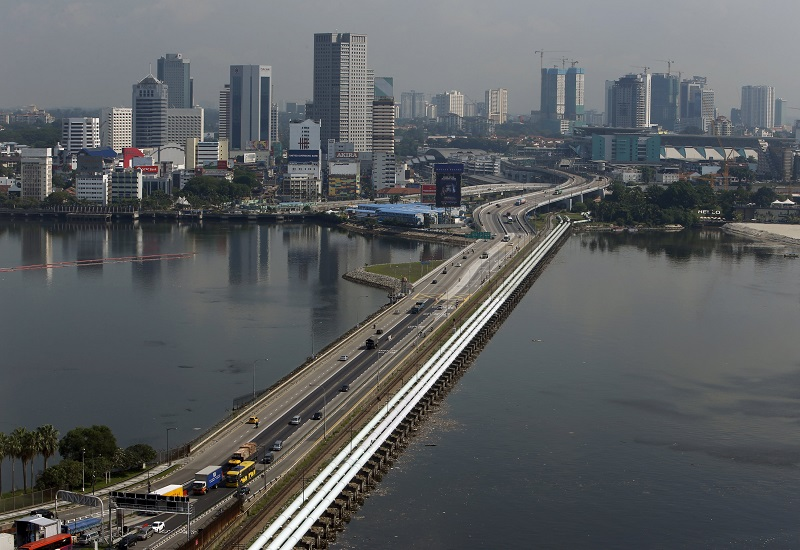 Hasni said that a total of 8,270 individuals have used the Periodic Commuting Arrangement facility, while a total of 327 individuals have used the Reciprocal Green Lane to cross the Johor-Singapore border up until August 31. — Reuters pic