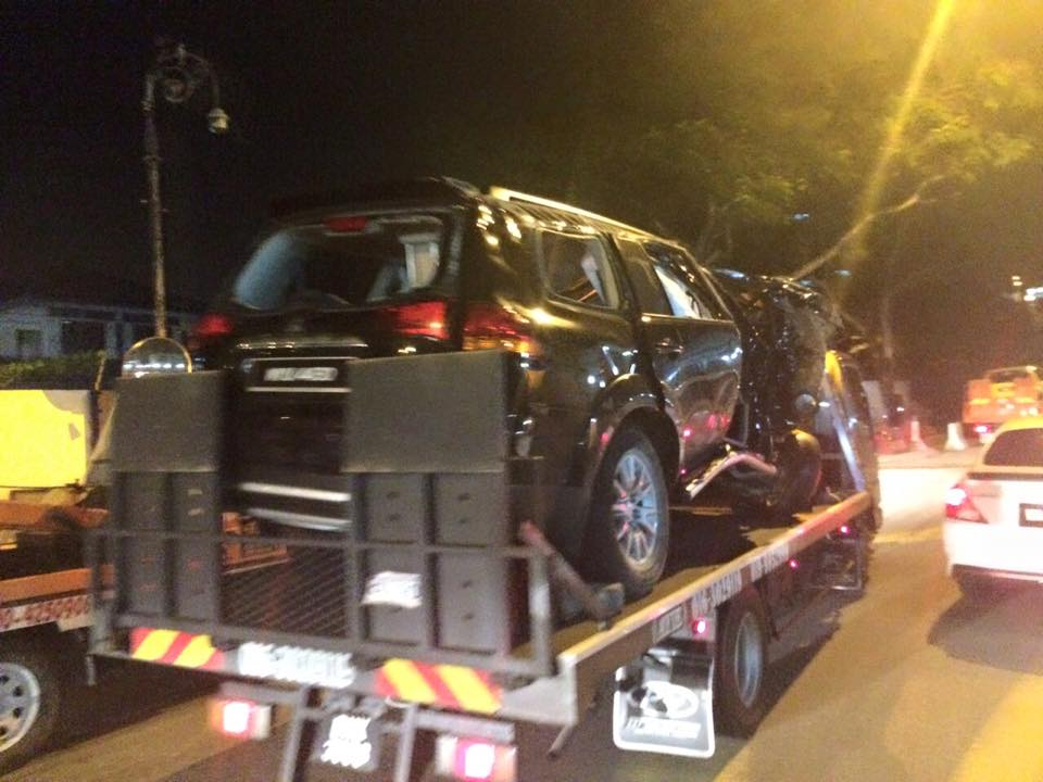 Picture shows the wrecked Mitsubishi Pajero vehicle being transported away from the accident scene. — Facebook pic