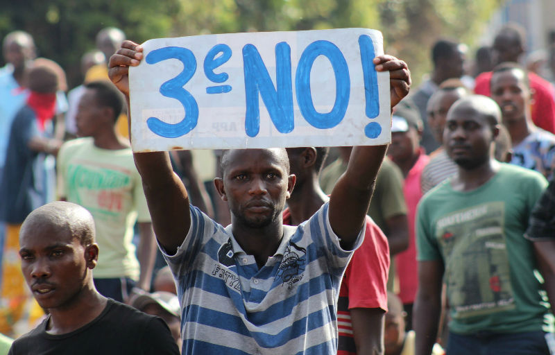 A protester holds a placard as they demonstrate against the ruling CNDD-FDD party's decision to allow Burundian President Pierre Nkurunziza to run for a third five-year term in office, in Bujumbura, May 4, 2015. — Reuters pic