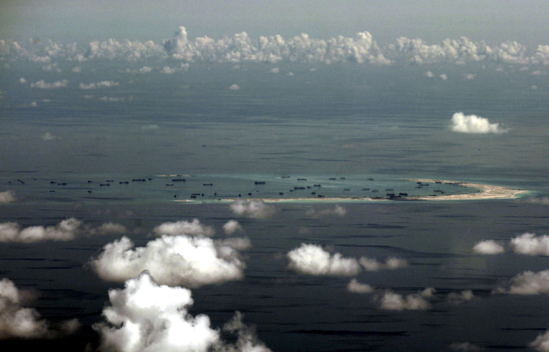 China has come under fire from the United States and its allies in recent months over its land reclamation activities in the South China Sea's disputed Spratly archipelago. — Reuters pic