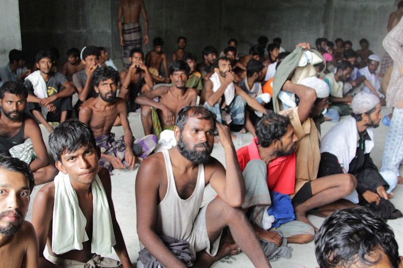 A group of rescued migrants mostly Rohingya from Myanmar and Bangladesh gathered on arrival at the new confinement area in the fishing town of Kuala Langsa in Aceh province May 15, 2015. – AFP pic
