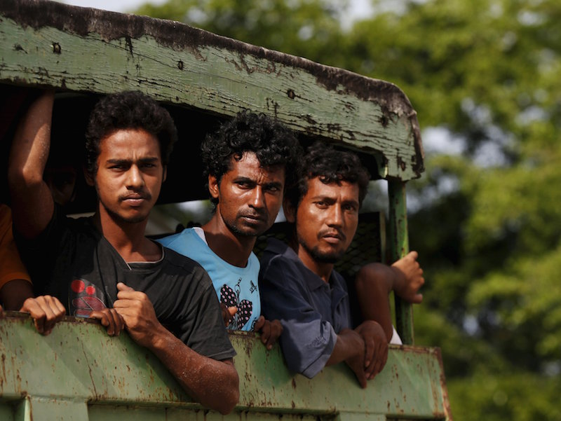 Rohinyga and Bangladeshi refugees are transported to a navy boat where they will be taken to mainland Malaysia, after they landed at Pantai Pasir Berdengung beach in Langkawi May 14, 2015. — Reuters pic