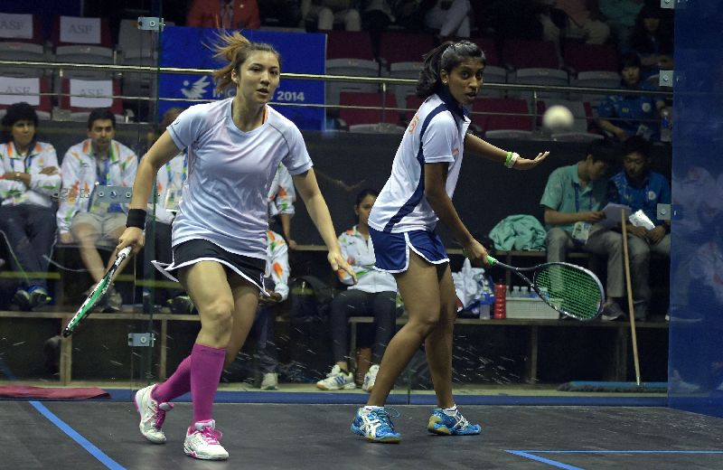 Delia Arnold (left) in succession dispatches the third seed, 11th seed and second seed and world number two Egyptian Raneem El Weleily to reach the semi-finals. — AFP file pic