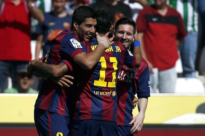 Barcelona's Luis Suarez celebrates a goal with team mates Lionel Messi and Neymar during their Spanish first division match against Cordoba in Cordoba May 2, 2015. — Reuters pic