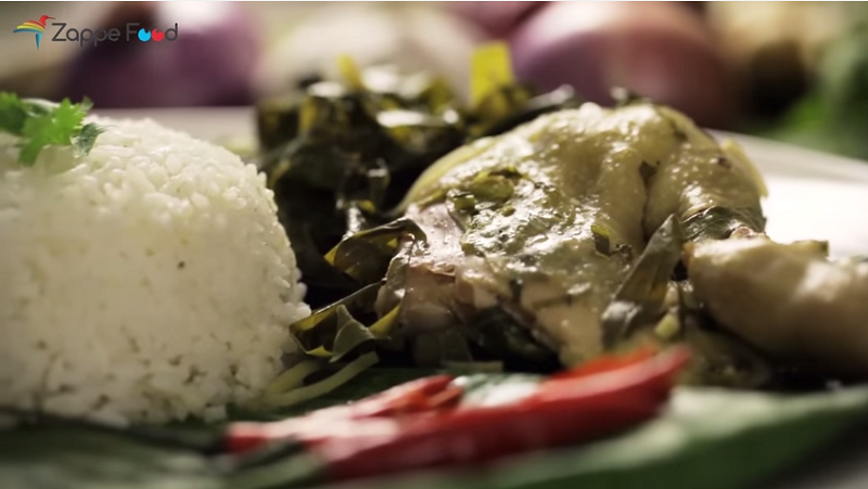 Screen capture of the video by Zappe Food showing 'ayam pansuh' served with white rice.