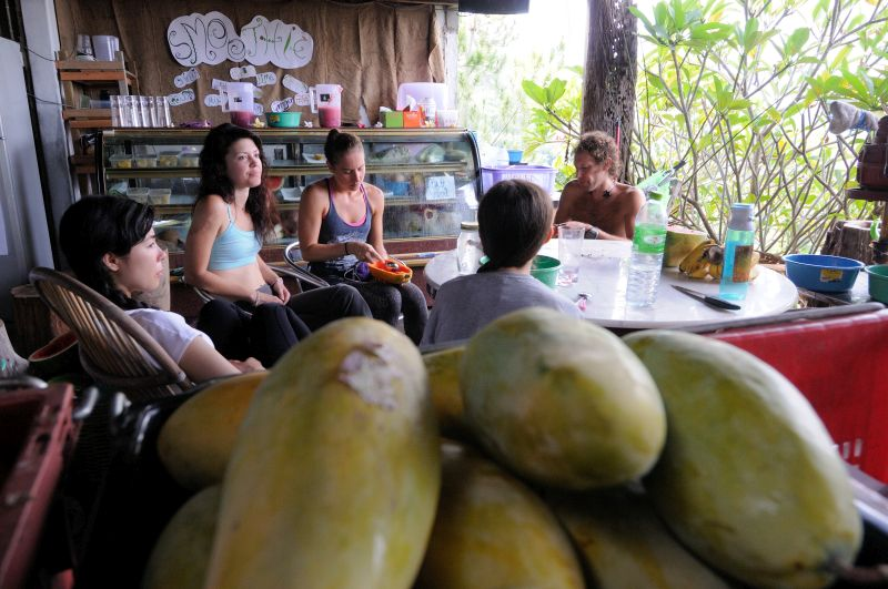 Participants enjoy a breakfast of fresh fruits and juices after a morning run at the Bao Sheng Durian Farm.