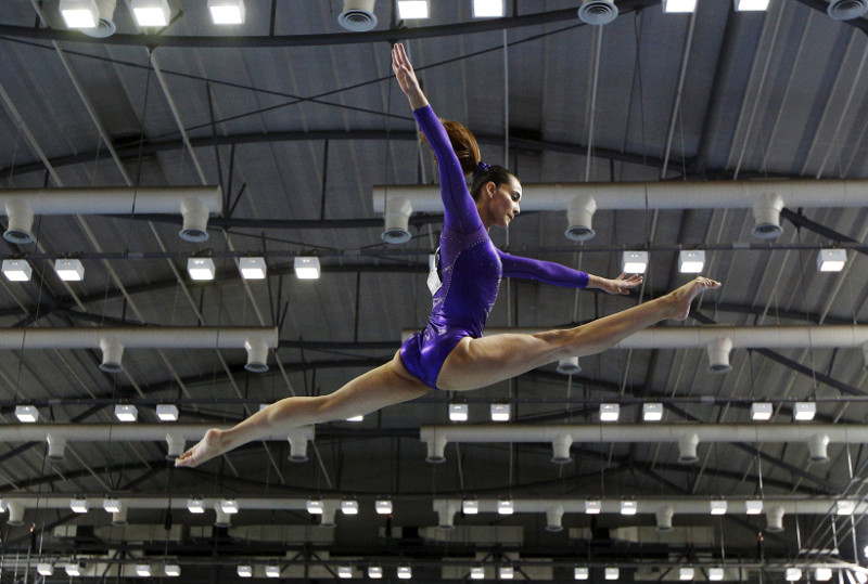 Malaysia's Farah Ann Abdul Hadi performs on the balance beam during the women's artistic gymnastics team final at the Southeast Asian (SEA) Games in Singapore, June 7, 2015. — Reuters pic