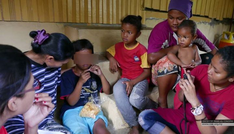 This picture, taken from the Centre for Orang Asli Concerns' (COAC) Facebook page, shows the girl (3rd left) who was reportedly bound and beaten up by three teachers in Kelantan.