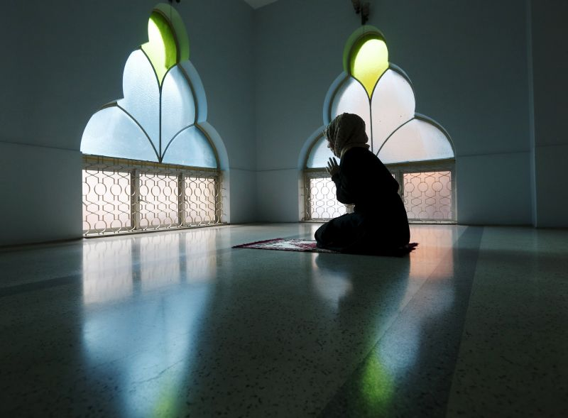 A woman prays at a mosque in Kuala Lumpur. ― Reuters pic