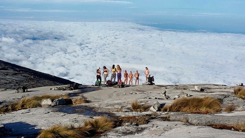 On Saturday, several images posted on Facebook and spread through Whatsapp showing a group of Caucasian-looking adults in various states of undress, posing on Mount Kinabalu.