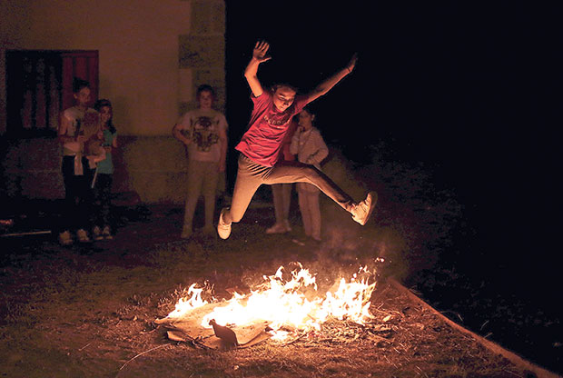 A girl jumps over a bonfire during the traditional Sant Joan (Saint John) night in Paredes, northern Spain early June 24, 2015. — Reuters pic
