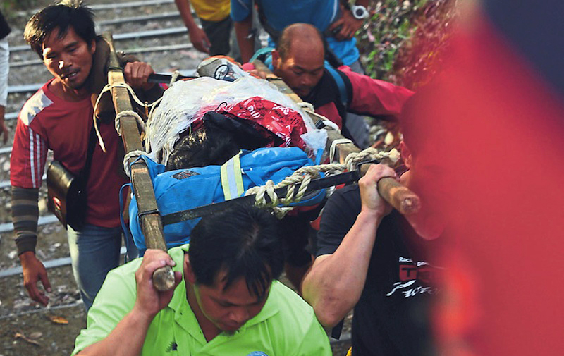 Picture shows an injured climber being brought down from Mount Kinabalu, June 6, 2015. — File pic