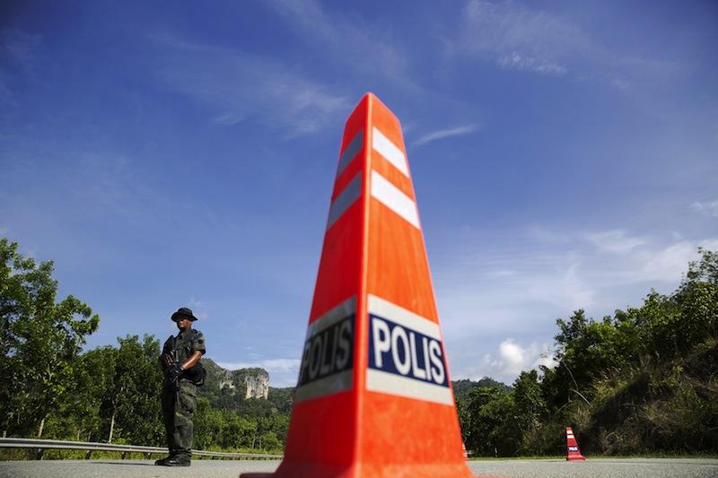 A police team rescued the victims in a raid at an oil palm plantation in Kampung Tasek, Belukar Semang. — Reuters pic