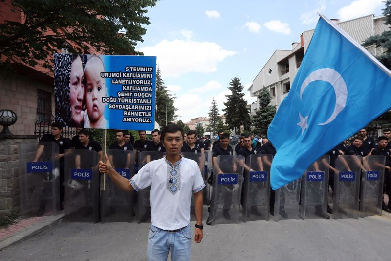 Uighurs living in Turkey protest the killings of Uighurs allegedly killed by Chinese security on July 5, 2009 in China's far-western Xinjiang Uighur Autonomous Region, outside the Chinese embassy in Ankara, on July 5, 2014. — AFP pic