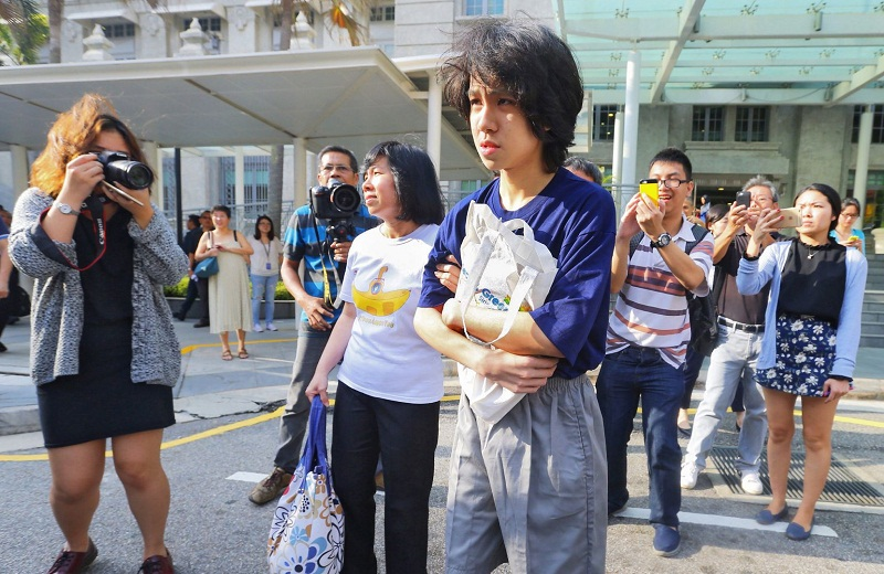 Amos Yee leaving the State Courts with his parents on July 6, 2015, after being sentenced to four weeks' jail, backdated to June 2nd. — TODAY pic