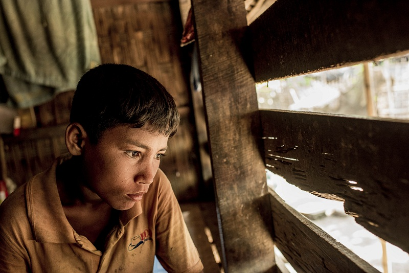 Jubair, 13, who was left behind when his mother and siblings fled Myanmar for Malaysia, in the Rohingya village of Thayet Oak, Myanmar, June 2, 2015.  — Picture by Tomas Munita for The New York Times