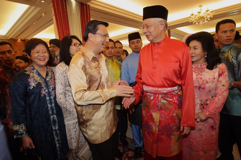 MCA president Datuk Seri Liow Tiong Lai said Low Yat retailers claimed that there had been a 40 to 50 per cent drop in sales. Picture shows Liow shaking hands with Prime Minister Datuk Seri Najib Tun Razak at a Raya Open House at Seri Perdana, Putrajaya, on July 17, 2015. — Picture by Choo Choy May