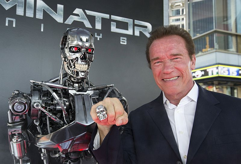 Arnold Schwarzenegger with the most famous killer robot of all. — Reuters pic