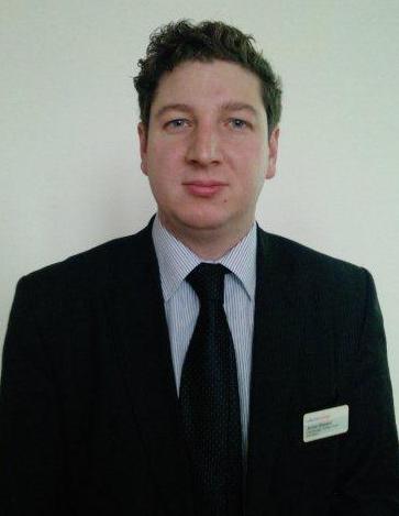 A headshot of James Steward from RailFutures.