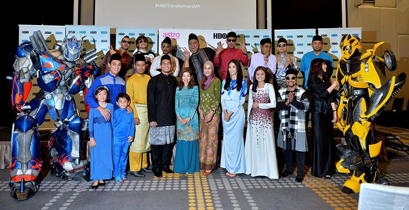 Optimus Prime (left), Bumblebee (right), the stellar voiceover talents and representatives from HBO Asia and Astro at a buka puasa launch recently. — File pic