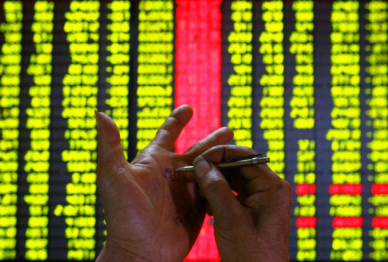Chinese blue chips shed 2.4 per cent to their lowest in 10 weeks as the education and property sectors were routed on worries over tighter government rules. — Reuters pic