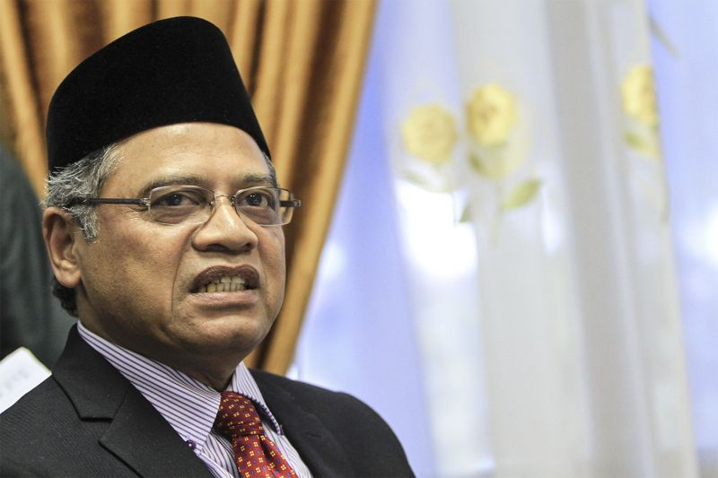 Jakim director-general Tan Sri Othman Mustapha says Muslims owning dogs and their needless contact with canines are 'highly disturbing' as both are against Islamic teachings. ― Picture by Yusof Mat Isa