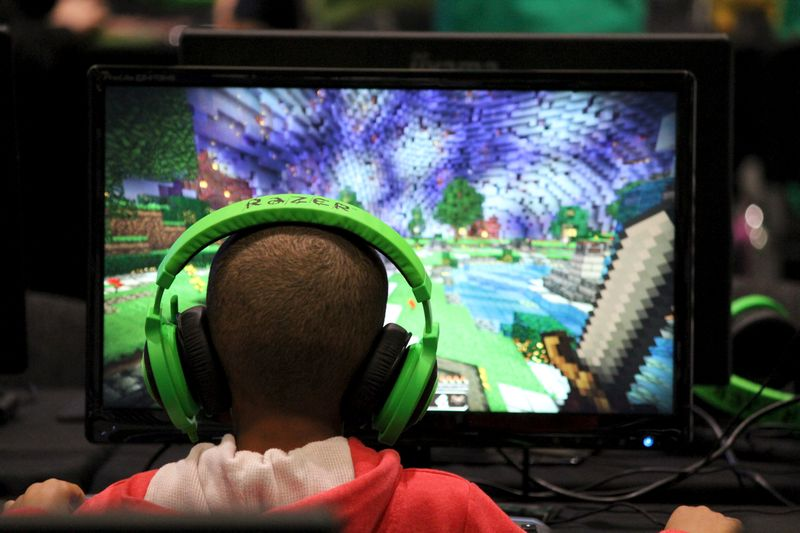 A child plays video game Minecraft at the Minecon convention in London July 5, 2015. — Reuters pic