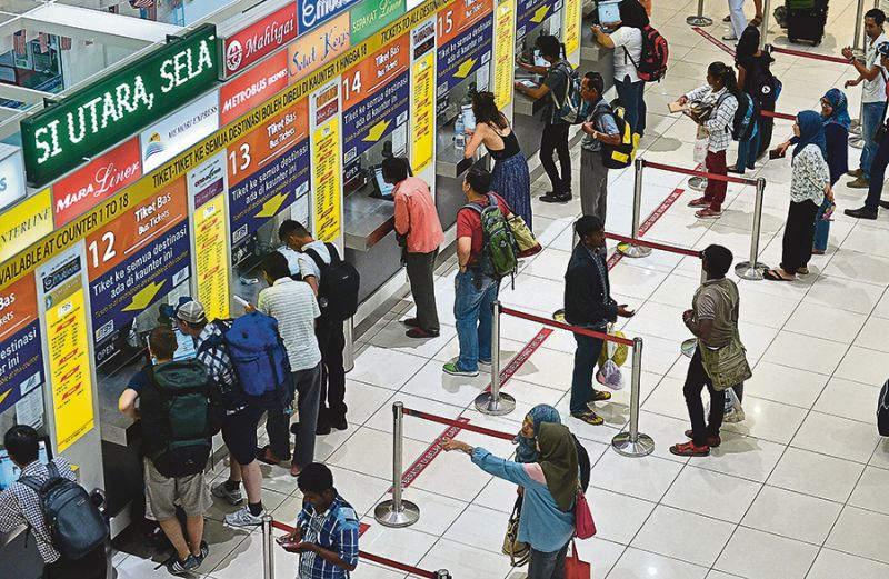 SPAD is urging the public to buy bus tickets for Hari Raya direct from the companies and not from agents and unauthorised sellers. — Picture by Razak Ghazali
