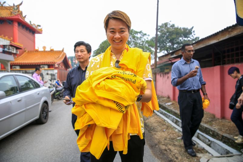 File pictures show a supporter buying the popular yellow Bersih 4 T-shirts from the Bersih 2.0 Petaling Jaya office. — Picture by Saw Siow Feng