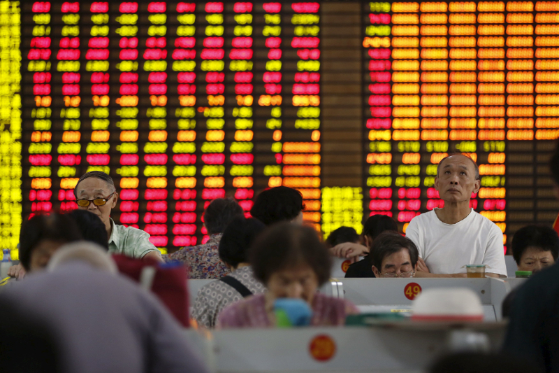 Investors look at computer screens showing stock information at a brokerage in Shanghai August 13, 2015. — Reuters pic