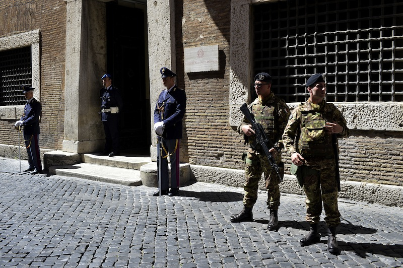 File photo of policemen and soldiers standing guard outside the Italian national Anti-mafia services headquarters on May 7, 2015 in Rome. — AFP pic