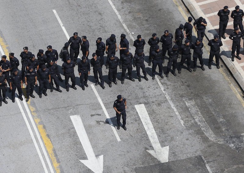 Police block a road ahead of a protest organised by pro-democracy group 'Bersih' in Kuala Lumpur August 29, 2015. — Reuters pic