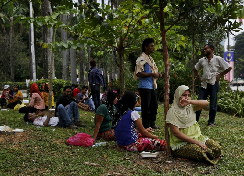 Refugees, many of whom say they are Rohingya, wait for access to the United Nations High Commission for Refugees (UNHCR) building in Kuala Lumpur, Malaysia. Picture released August 12, 2015. ― Reuters pic