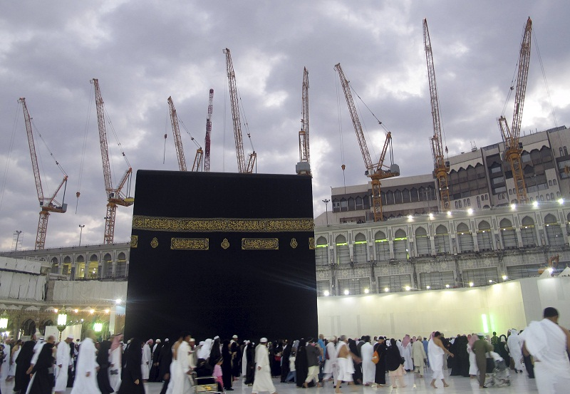 Construction cranes surround the Grand Mosque in the holy city of Mecca in this January 6, 2013 file photo as Muslim pilgrims circle the Kaaba and pray during Umrah. — Reuters pic