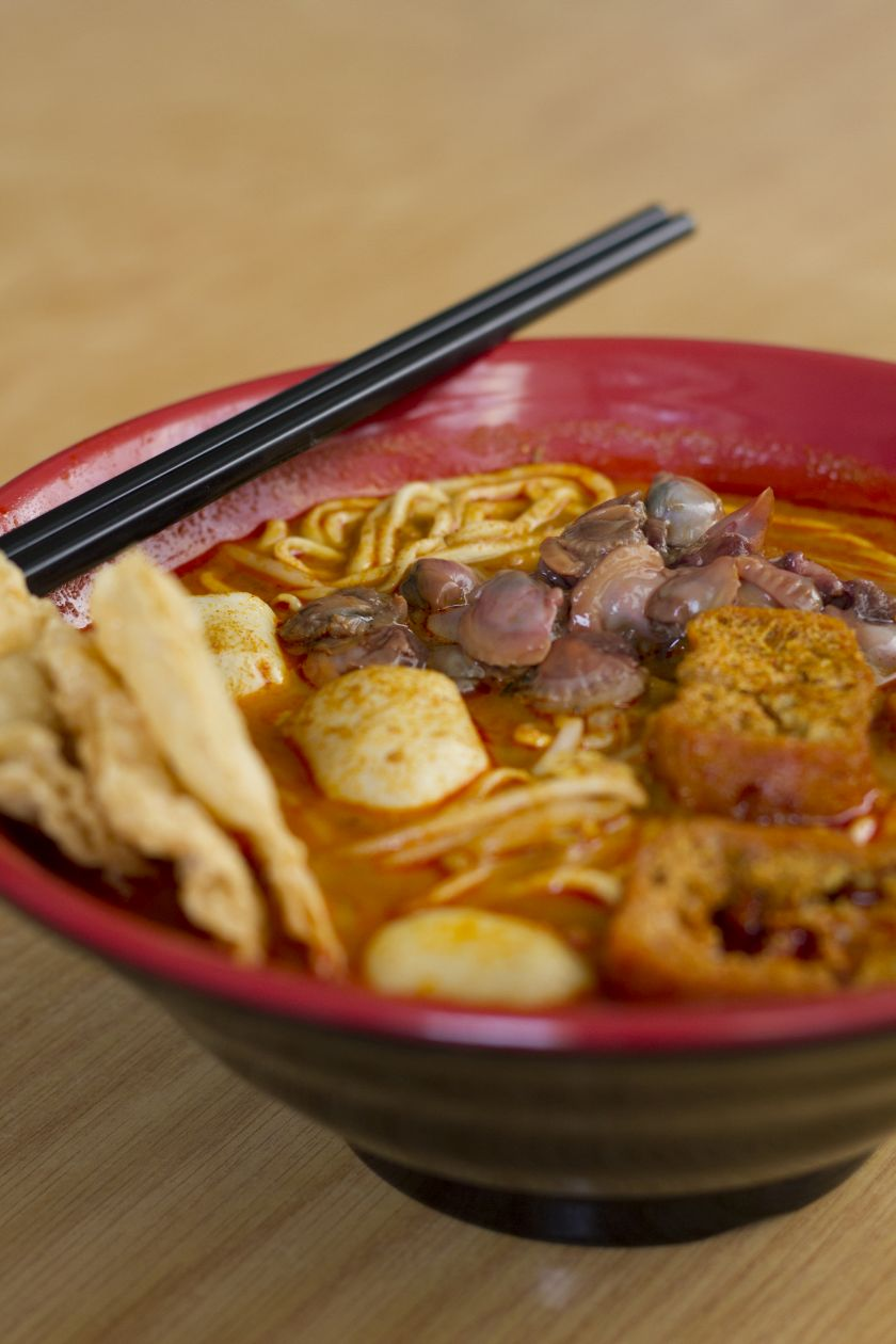 Enjoying curry laksa in Kuala Lumpur rates as the No. 2 food experience in 'Lonely Planet's Ultimate Eatlist.' — Picture by CK Lim